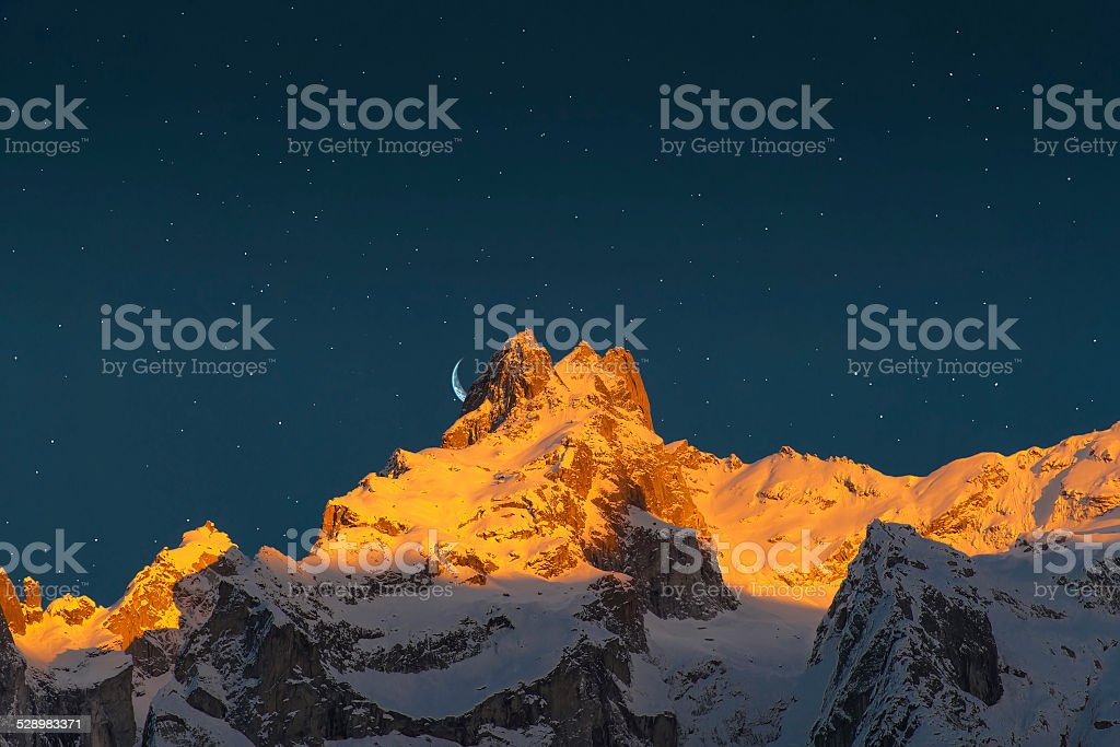 last sun of the mountains stock photo