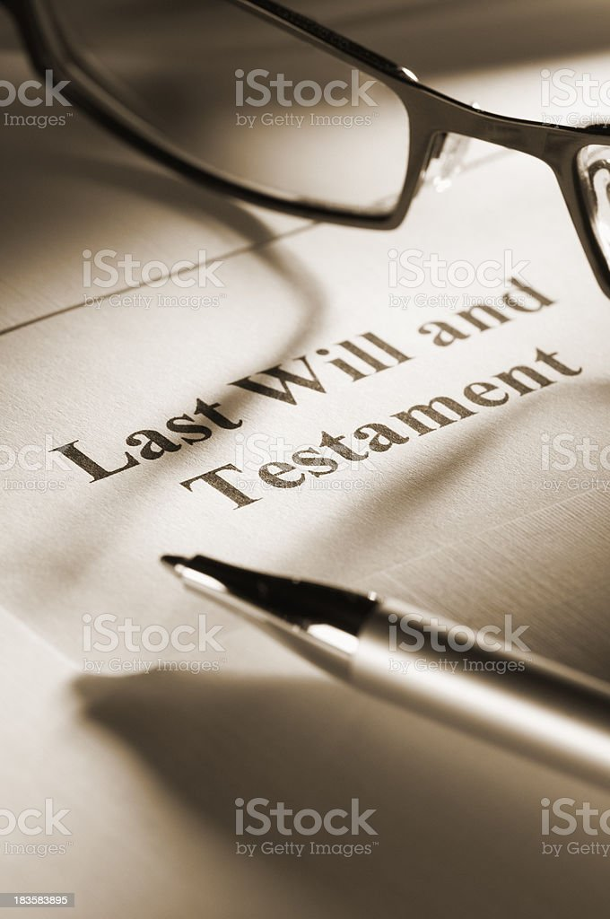 Last will and testament with ballpoint pen and glasses royalty-free stock photo