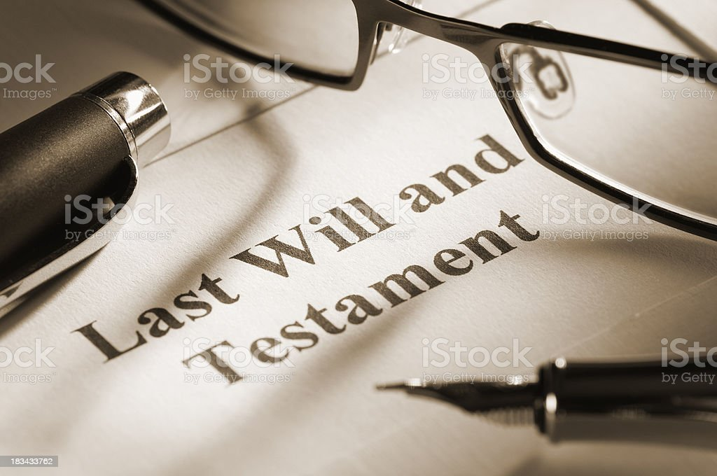 Last will and testament with fountain pen and glasses royalty-free stock photo