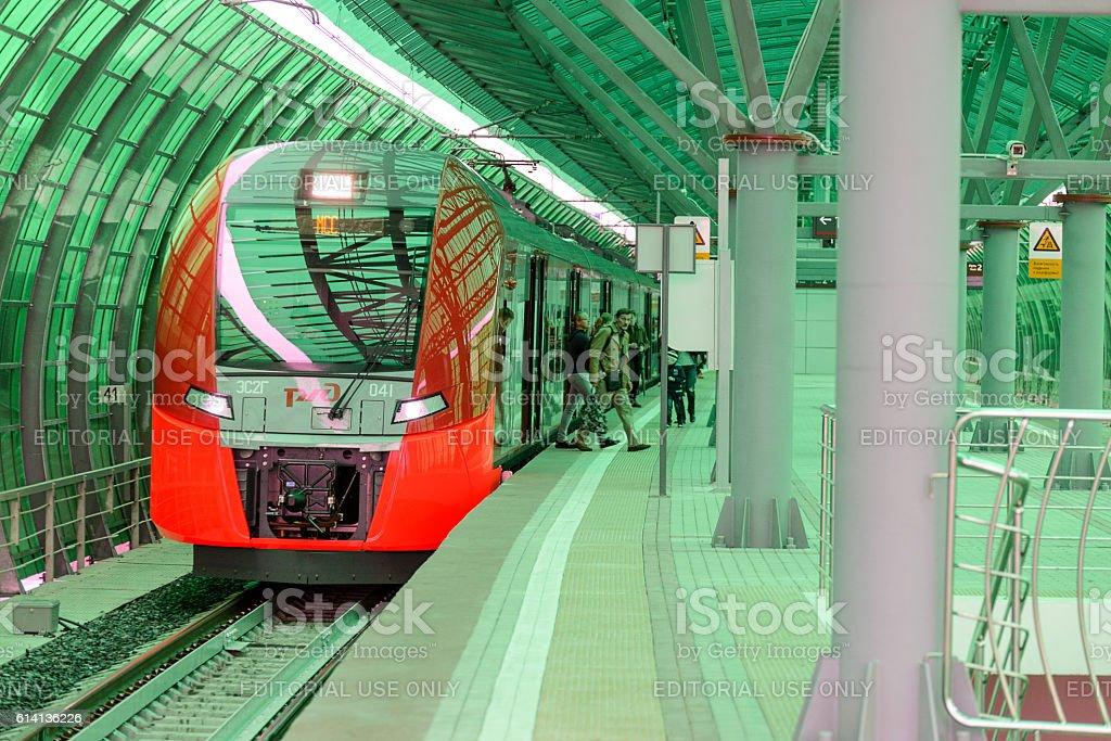Lastochka commuter train at the railway station stock photo
