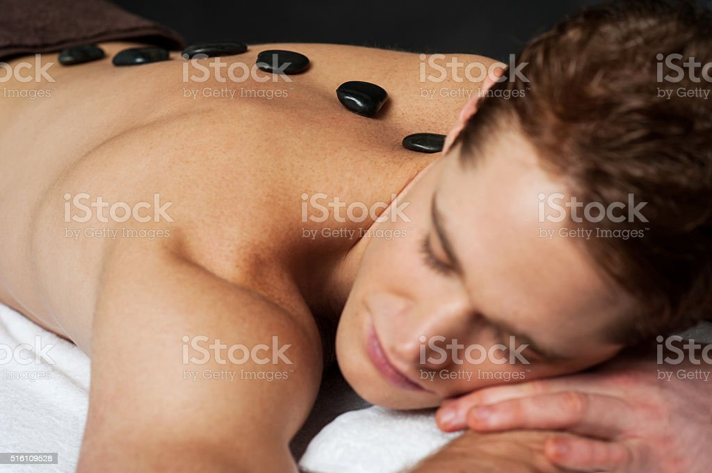 Lastone therapy for young man stock photo