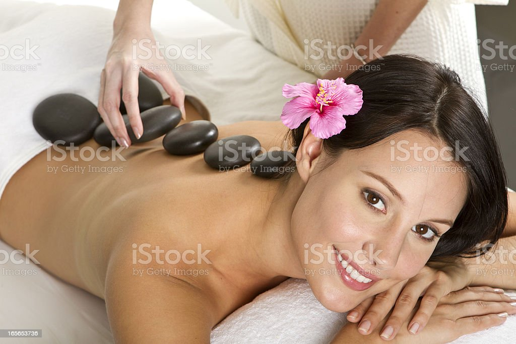 lastone therapy massage in a spa royalty-free stock photo