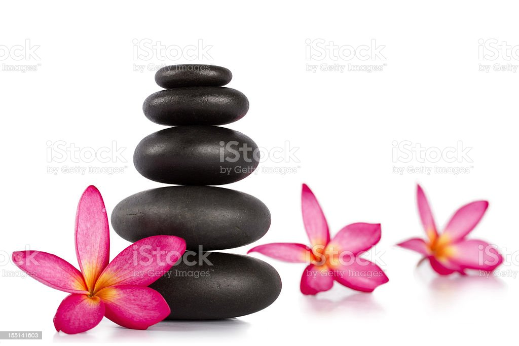 Lastones with frangipani flower for massage therapy isolated on white royalty-free stock photo