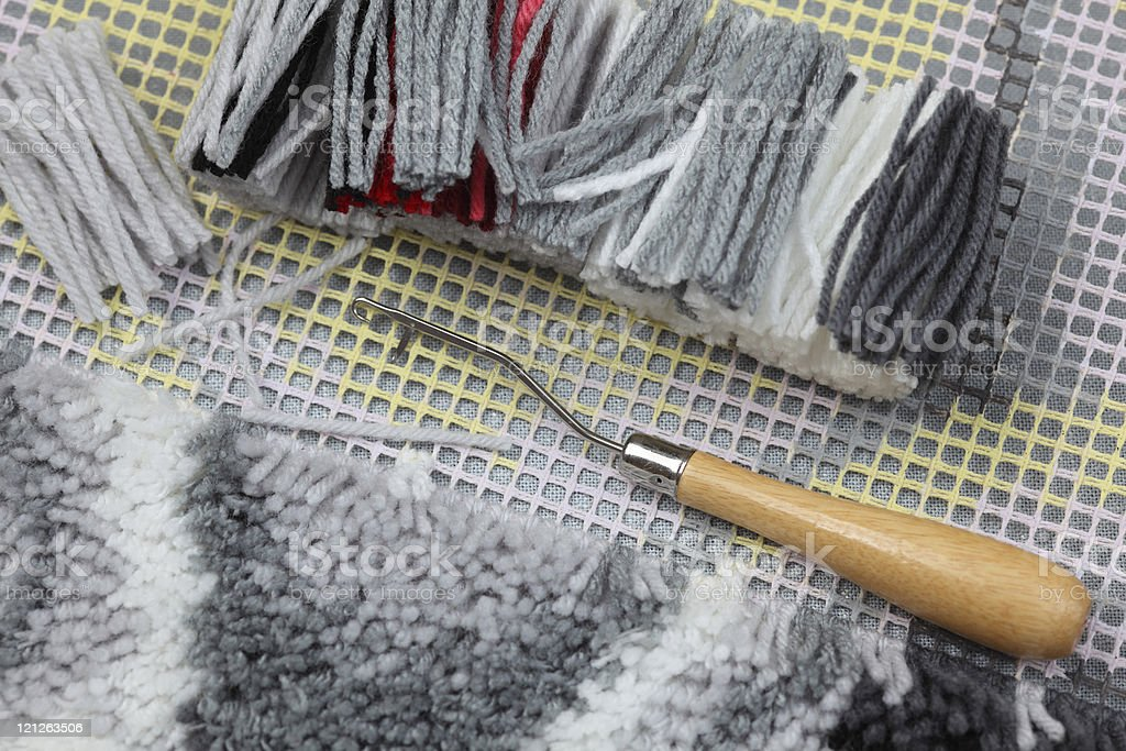 Latch Hook (handmade carpet weaving) stock photo