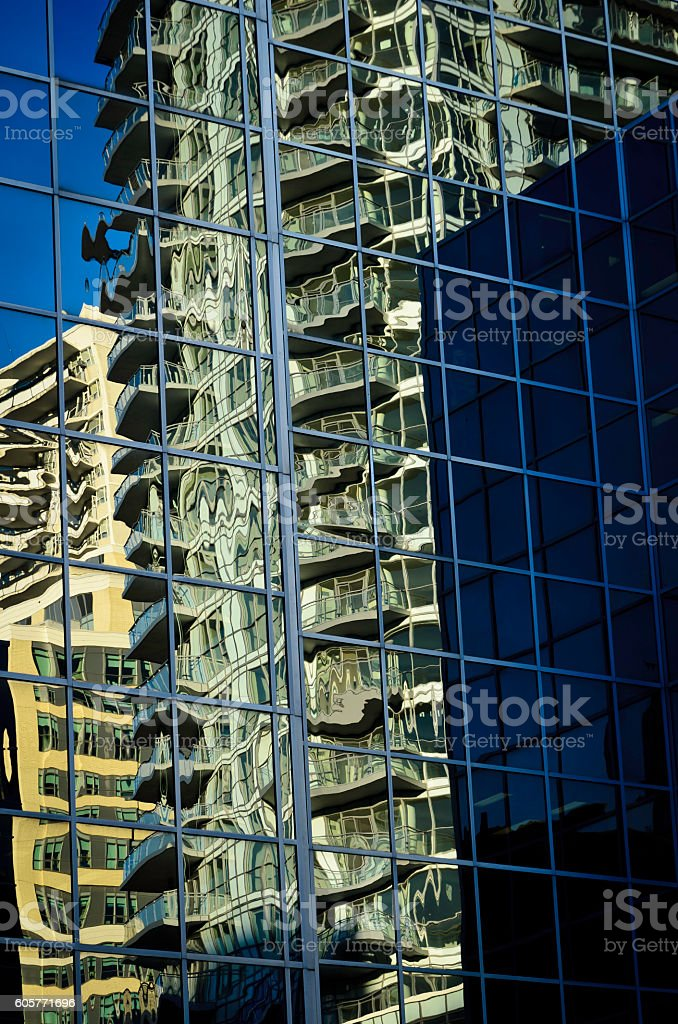 Late afternoon reflections in glass covered office building royalty-free stock photo