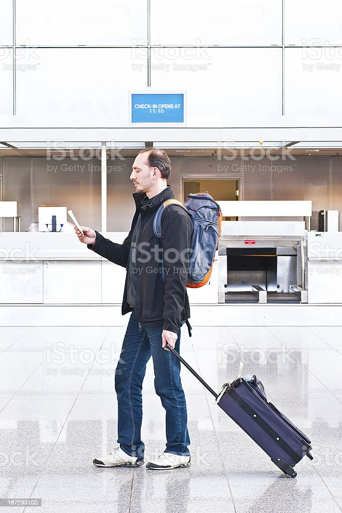 Late Backpacker on Airport stock photo