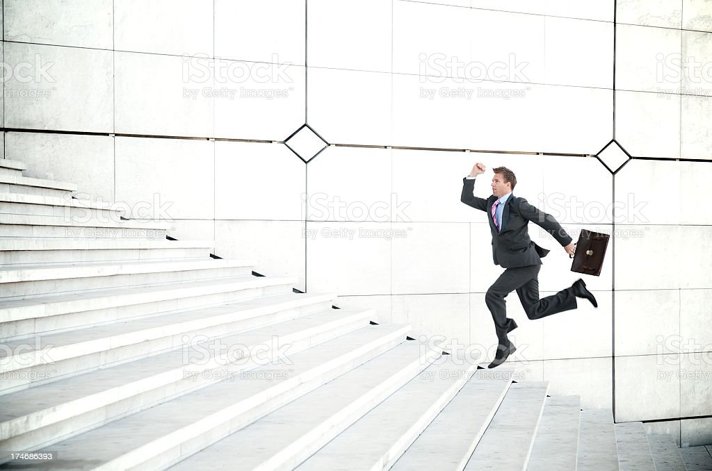 Late Businessman Running Outdoors Up Long White Staircase royalty-free stock photo