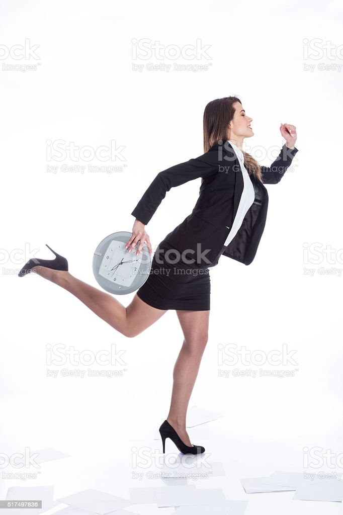 Late busy business woman running against time stock photo