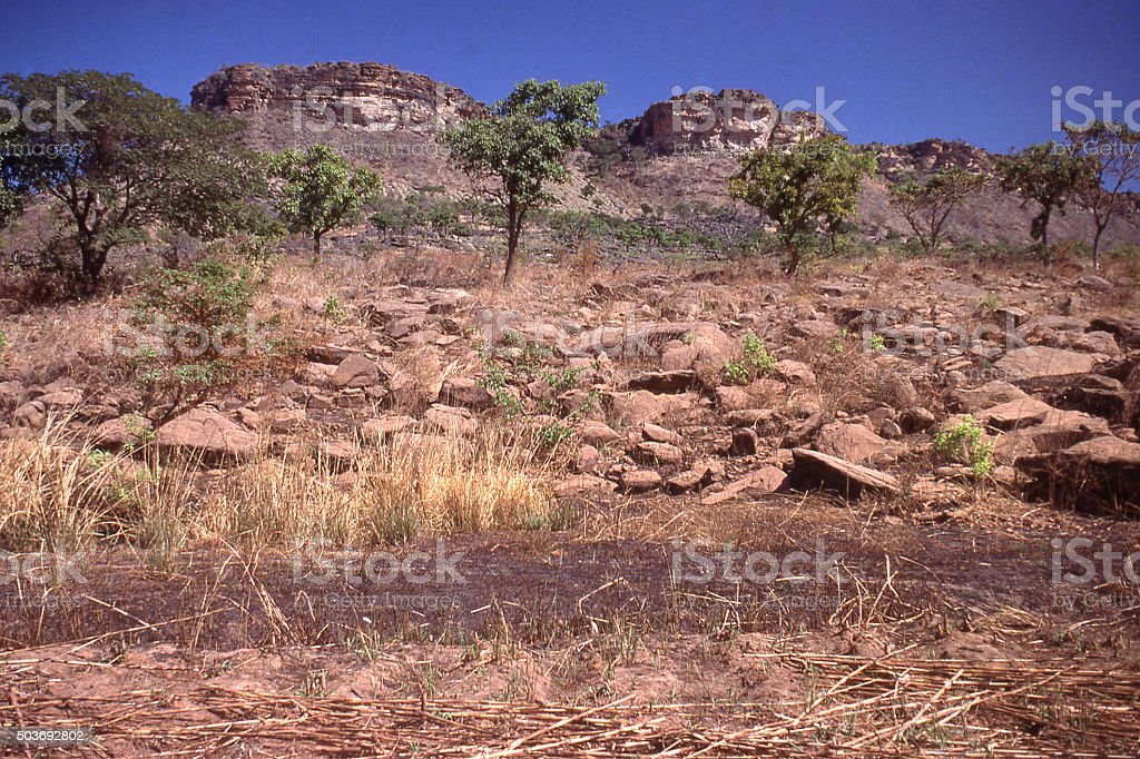 Late dry-seaon rural landscape rocky escarpment central Togo West Africa stock photo