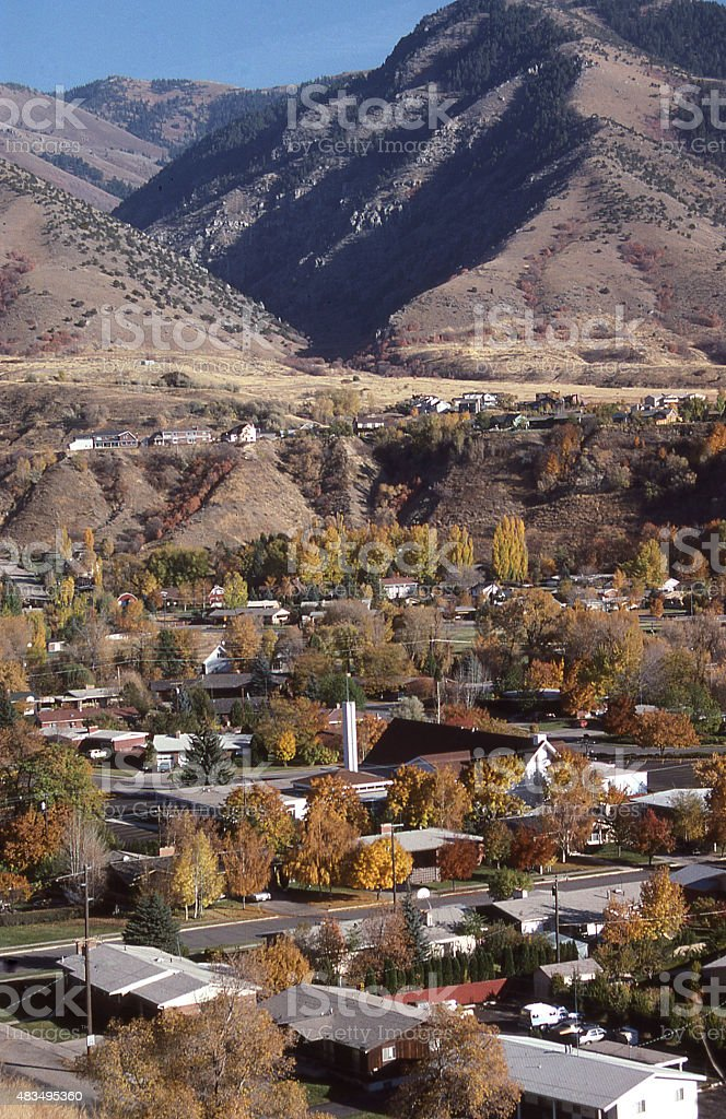 Late fall below Wasatch Mountains and suburban neighborhood Logan Utah stock photo
