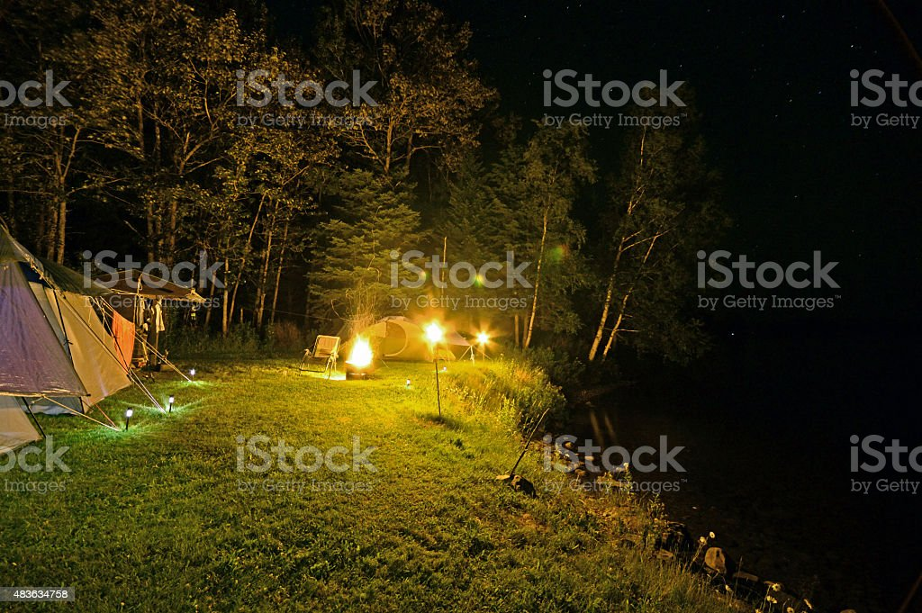 Late Night Camp Site With Fire and Torches stock photo