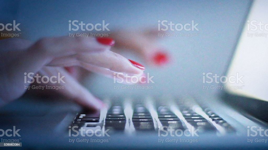 Late night online session. stock photo