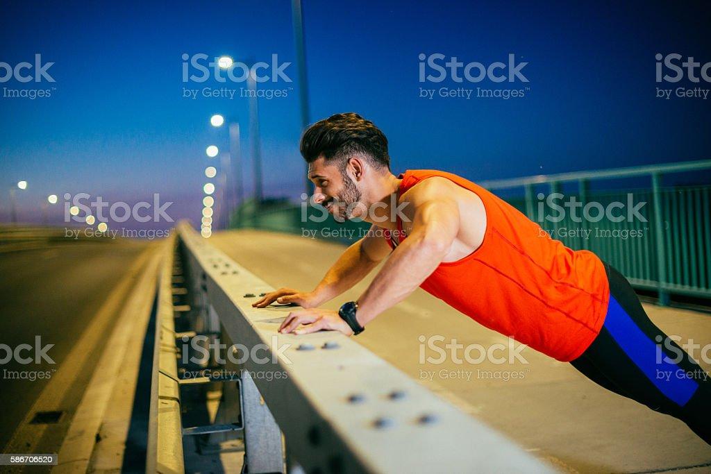 Late night push ups next to highway stock photo