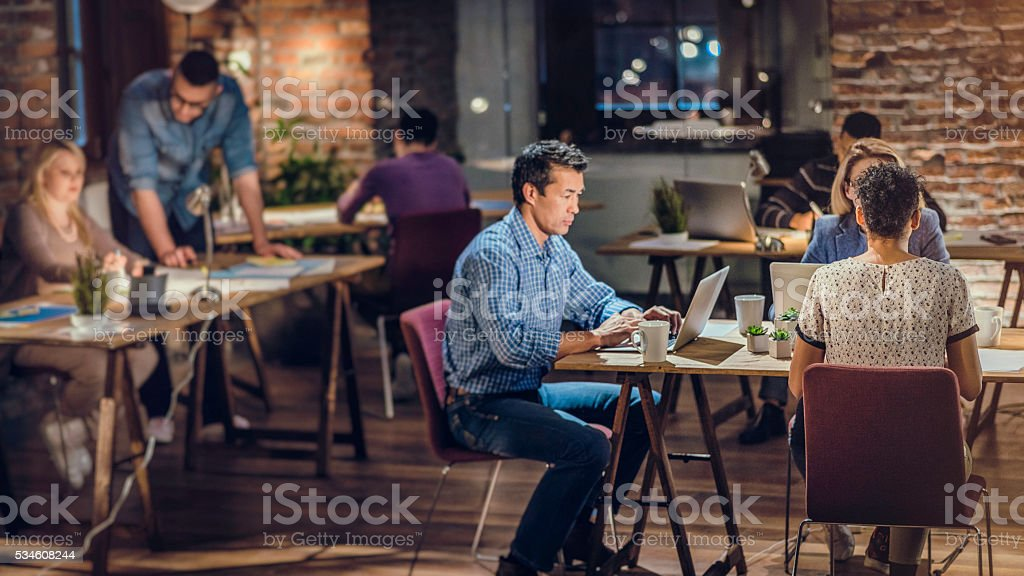 Late night working in trendy office stock photo
