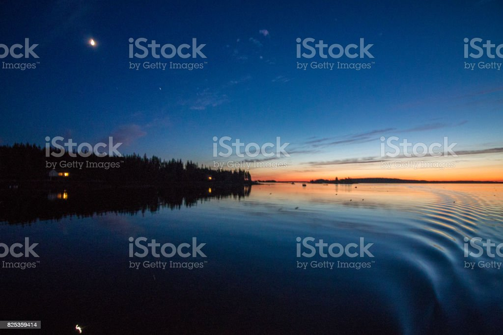 Late sunset on a boat in midcoast Maine stock photo