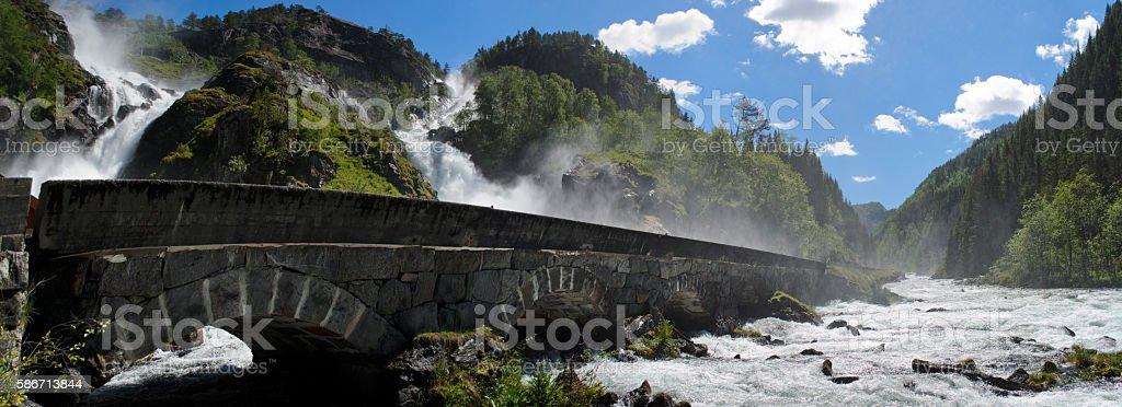 Latefossen waterfall with stone bridge in Norway stock photo