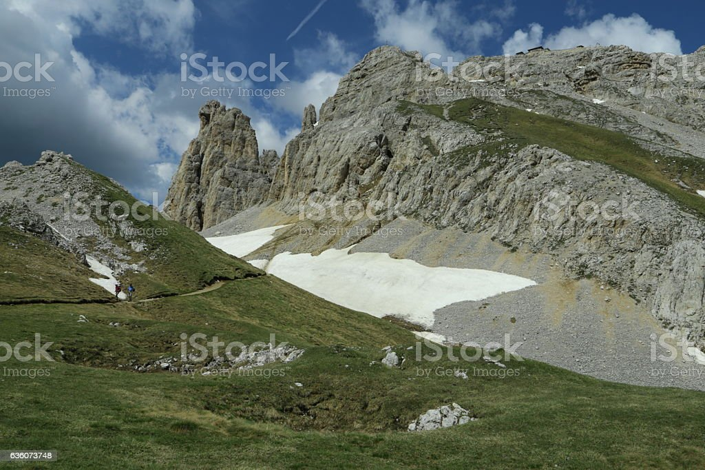 Latemar group and 'Torre di Pisa' refuge with some snow stock photo