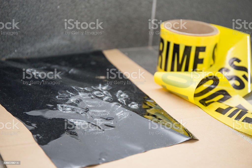 latent footprint evidence with crime scene tape in crime scene stock photo