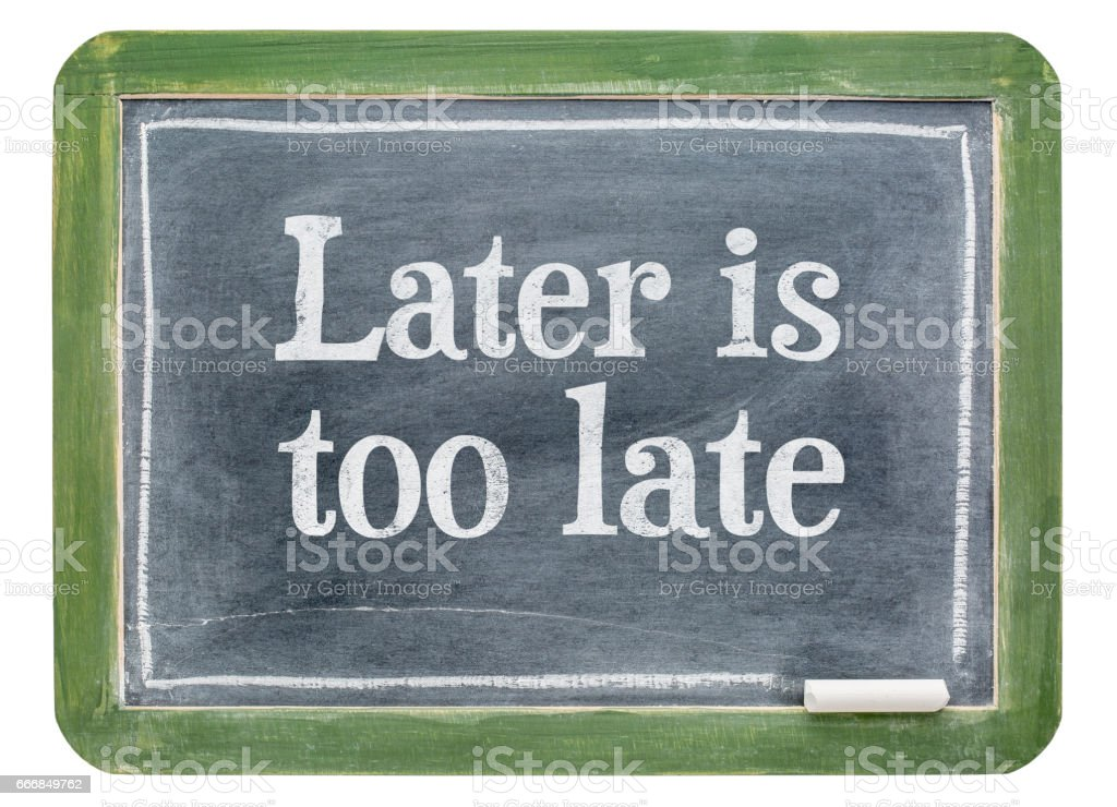 Later is too late - motivational text on blackboard stock photo