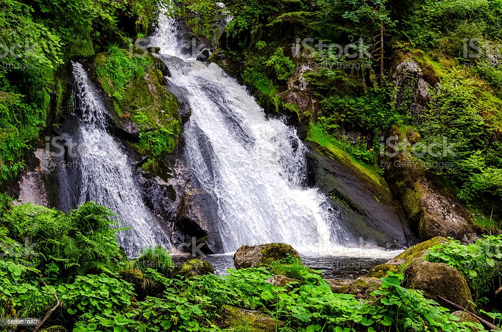 Lateral view on a strong waterfall in Triberg, Germany stock photo