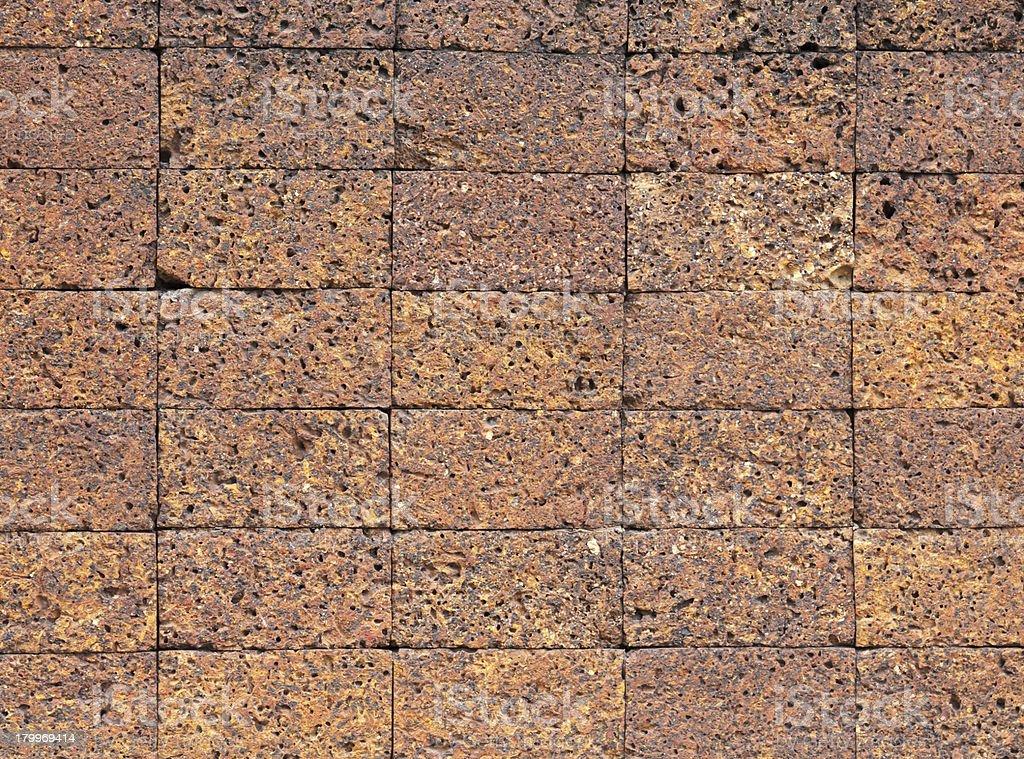 Laterite stone brick wall. royalty-free stock photo