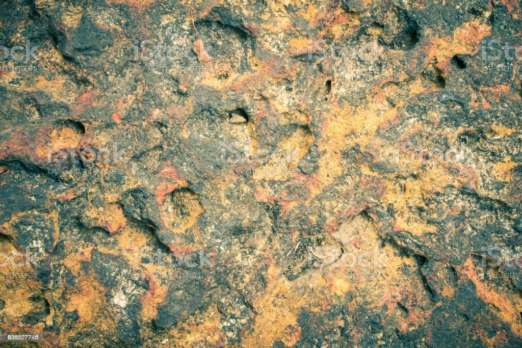 Laterite Stone Texture or Stone Background for Design in Vintage Tone stock photo