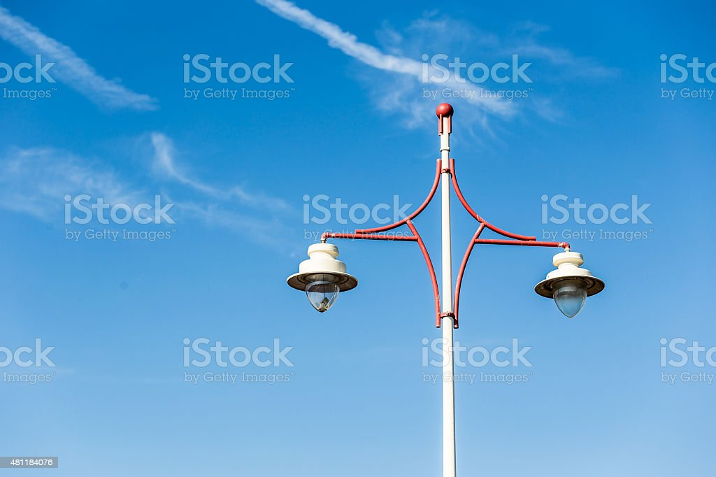 Latern post light on blue sky with a few clouds stock photo