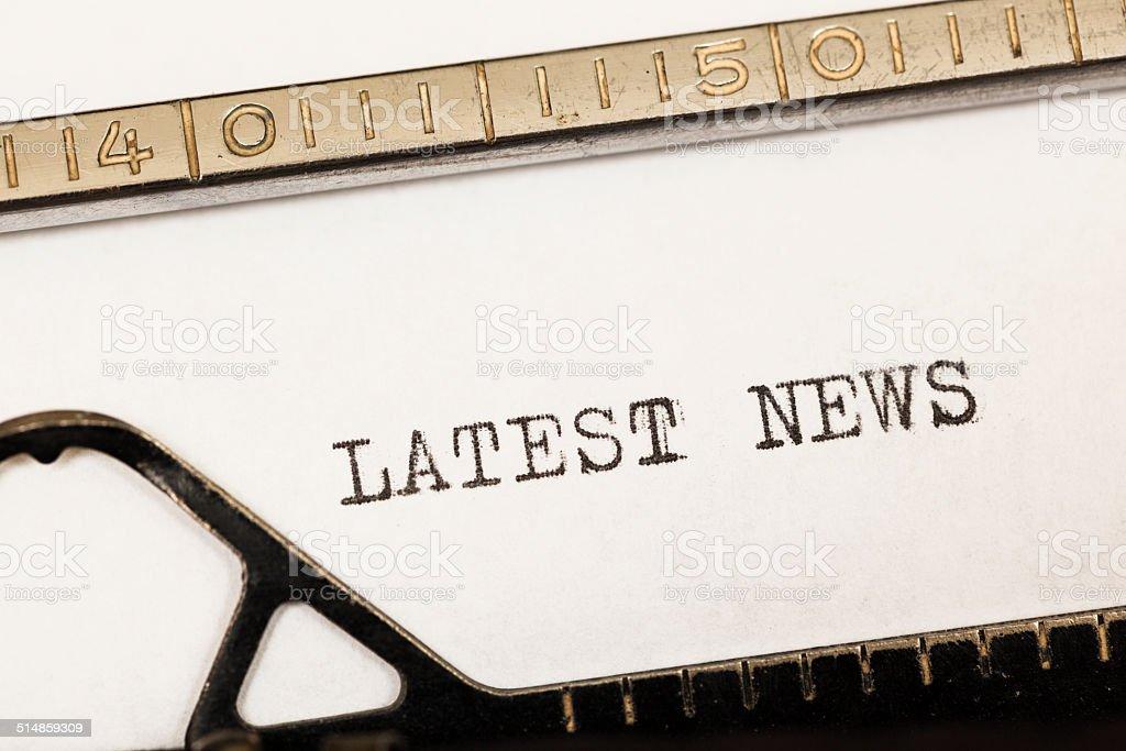 Latest news written on old typewriter. stock photo