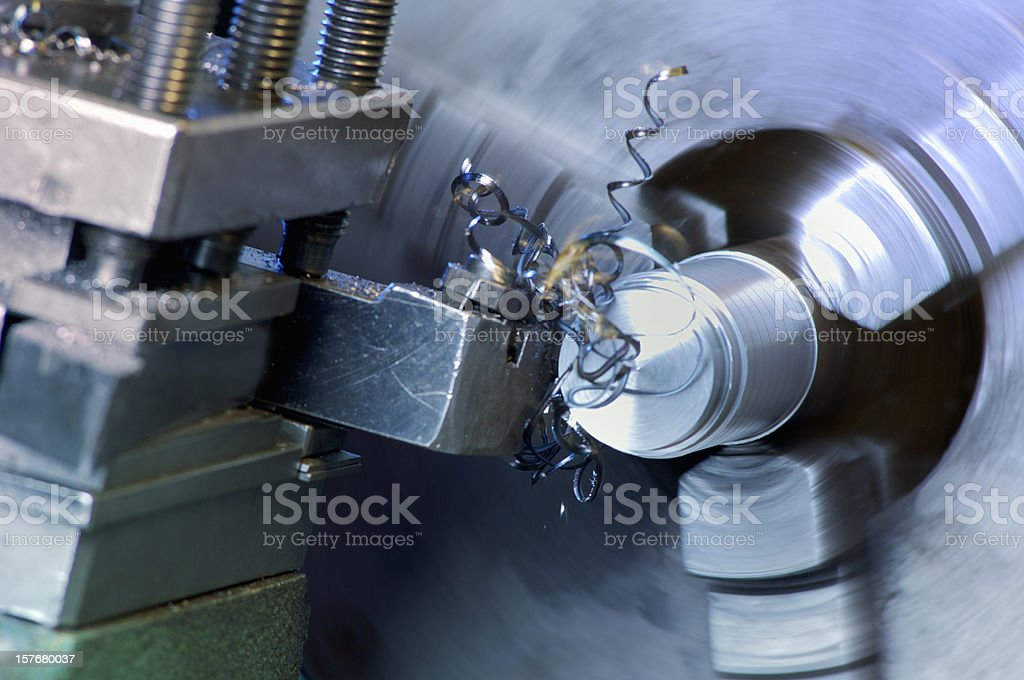 Lathe in operation cutting stainless steel stock photo