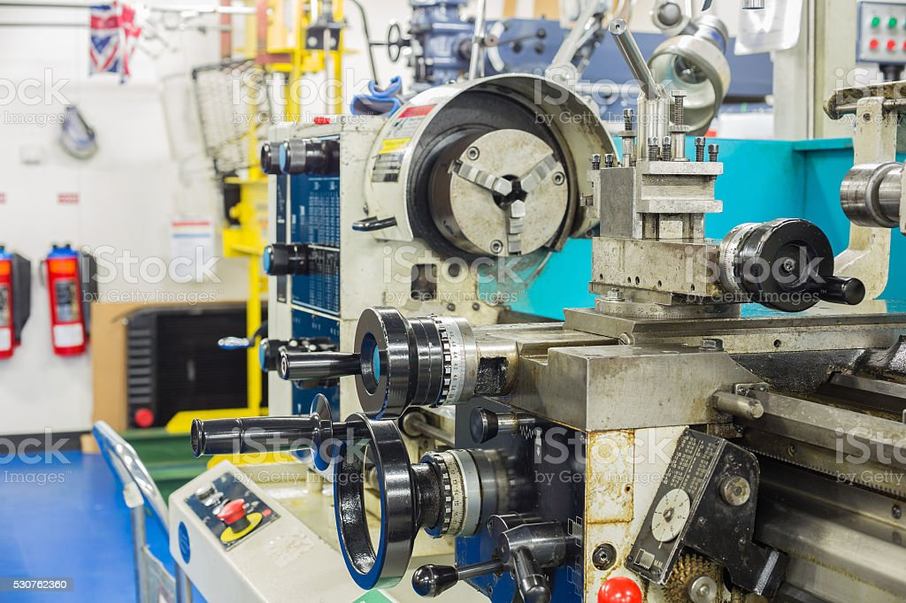 Lathe machine  cutting work and finished work in heavy industry stock photo
