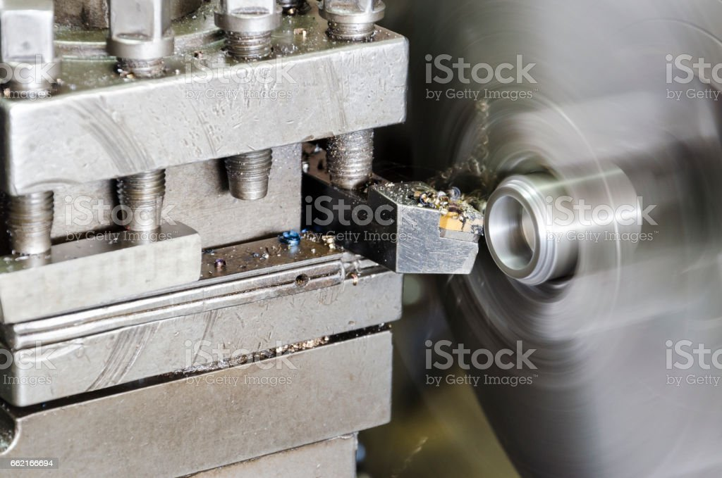 lathe machine in a workshop, Part of the lathe. Lathe machine is operation on the work shop. stock photo