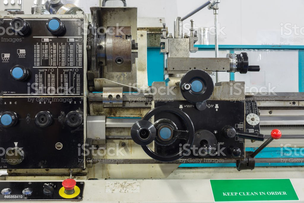 Lathe machine in workshop for cutting material and make thread in heavy industry stock photo
