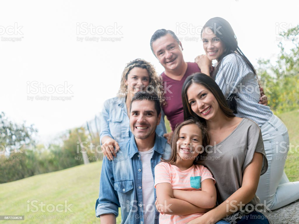 Latin American family portrait outdoors stock photo