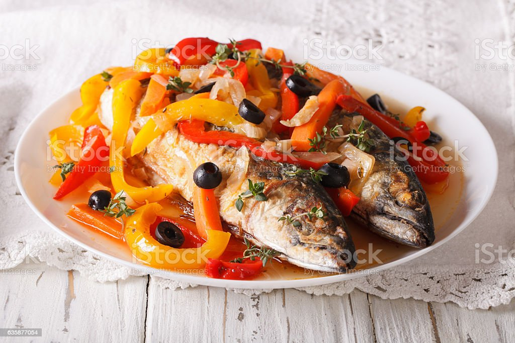 Latin American Food: escabeche of mackerel fish with vegetables stock photo