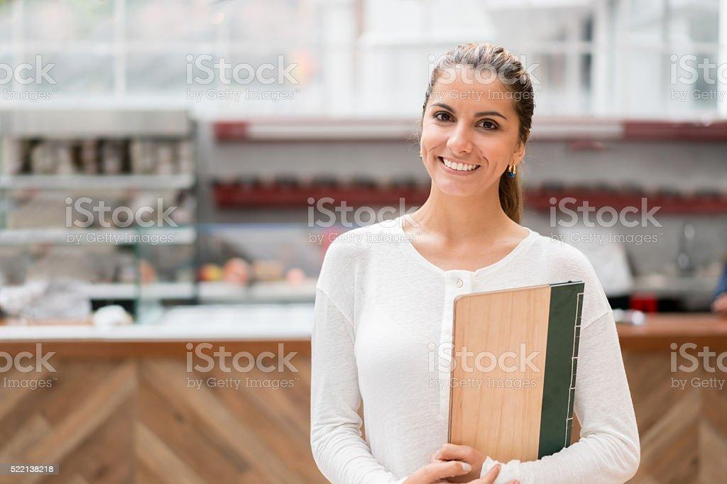 Latin American waitress at a restaurant stock photo