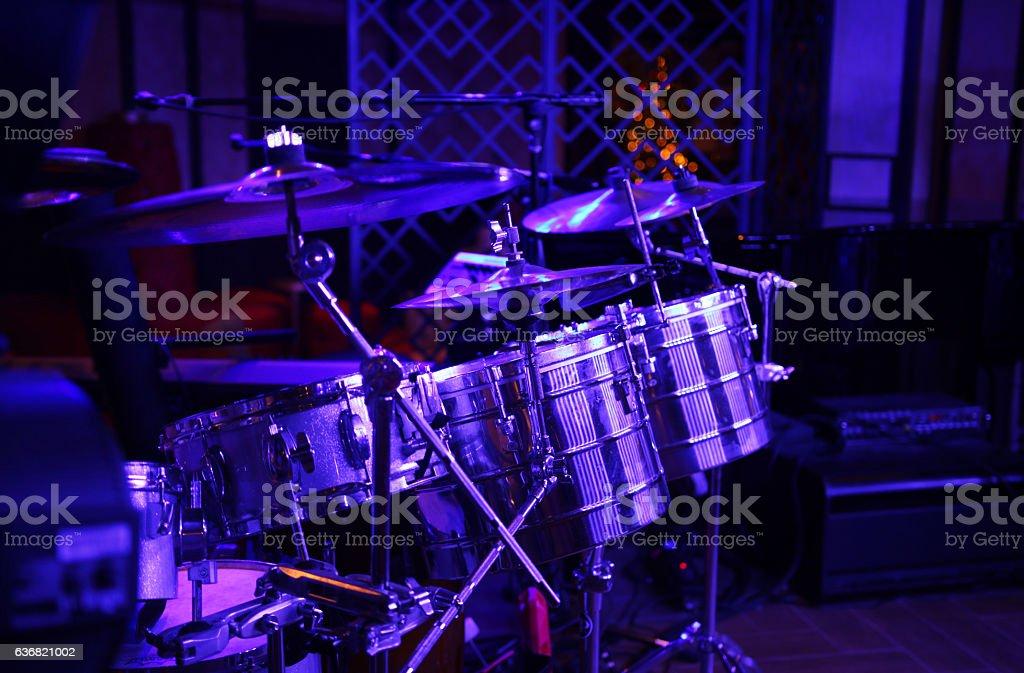 Latin band drum kit under purple blue stage lights stock photo