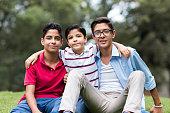 Latin boys embracing and smiling at camera