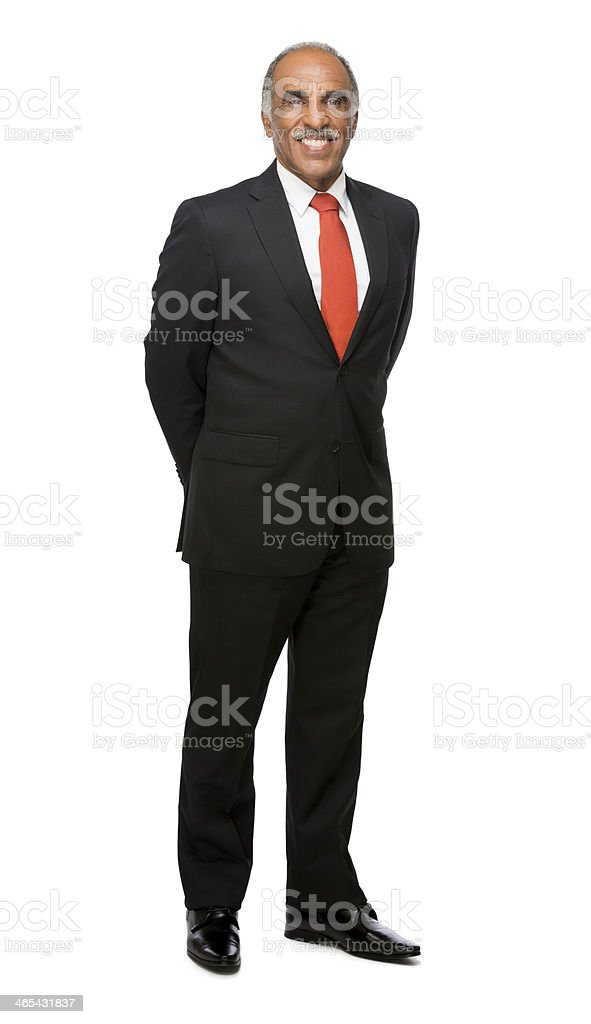 Latin business executive with hands behind him stock photo