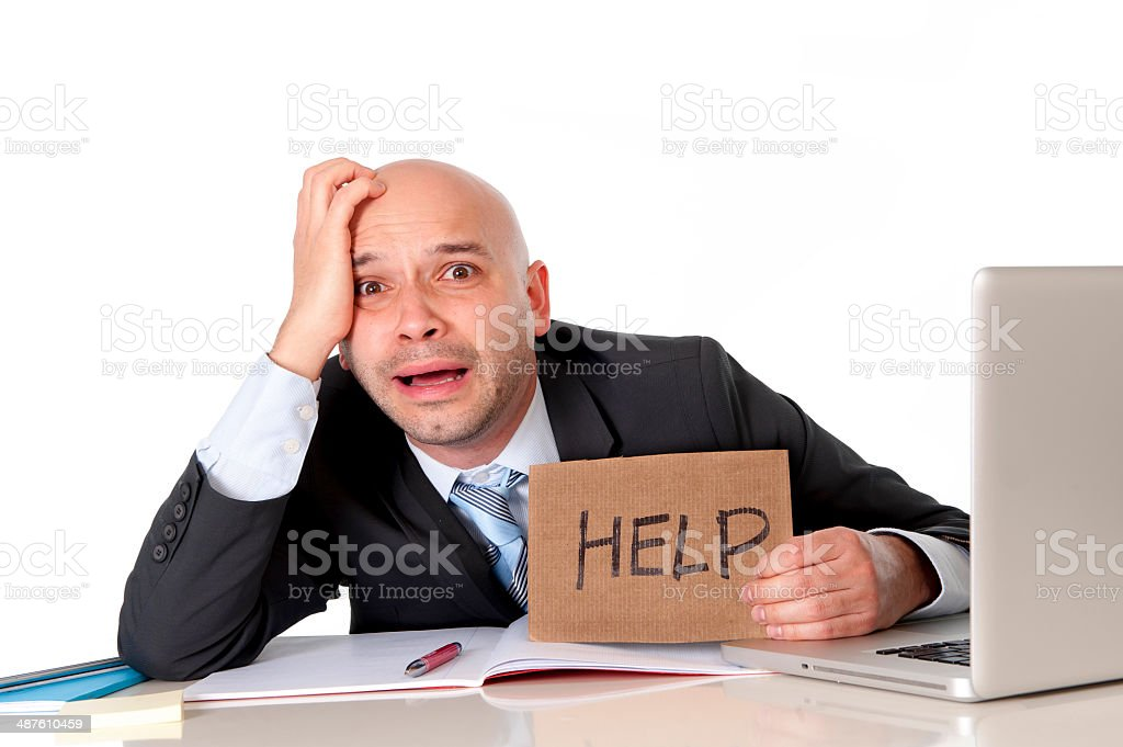 latin business man overworked in stress holding help sign stock photo