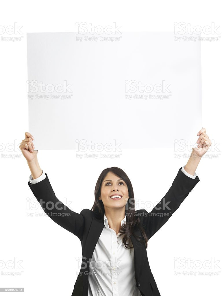 Latin business woman holding a big sign stock photo