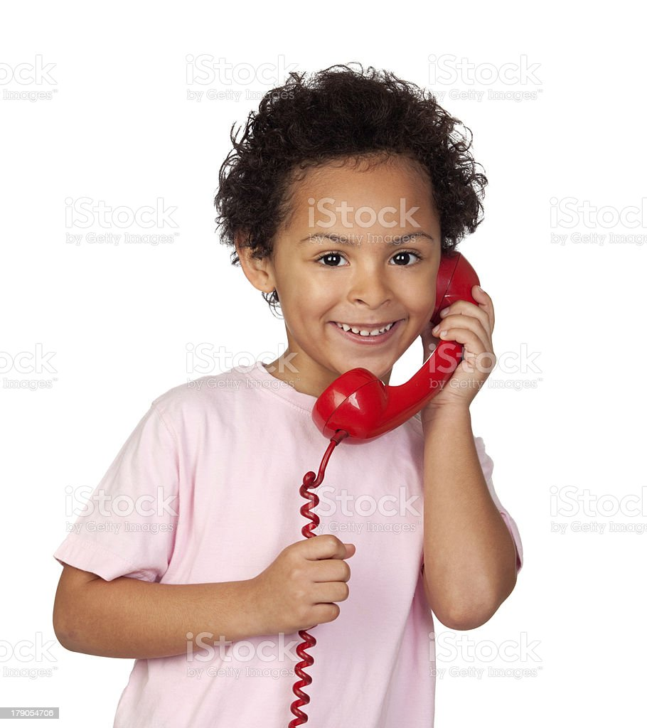 Latin child with red phone royalty-free stock photo