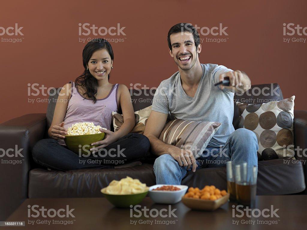 Latin couple watching TV royalty-free stock photo