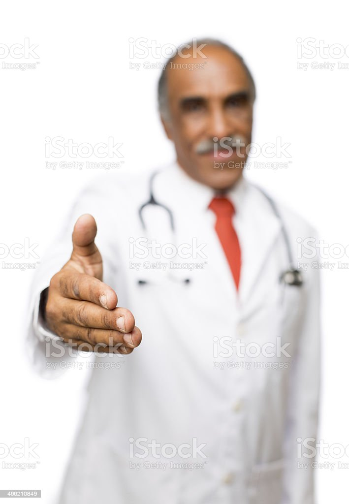 Latin doctor offering hand royalty-free stock photo