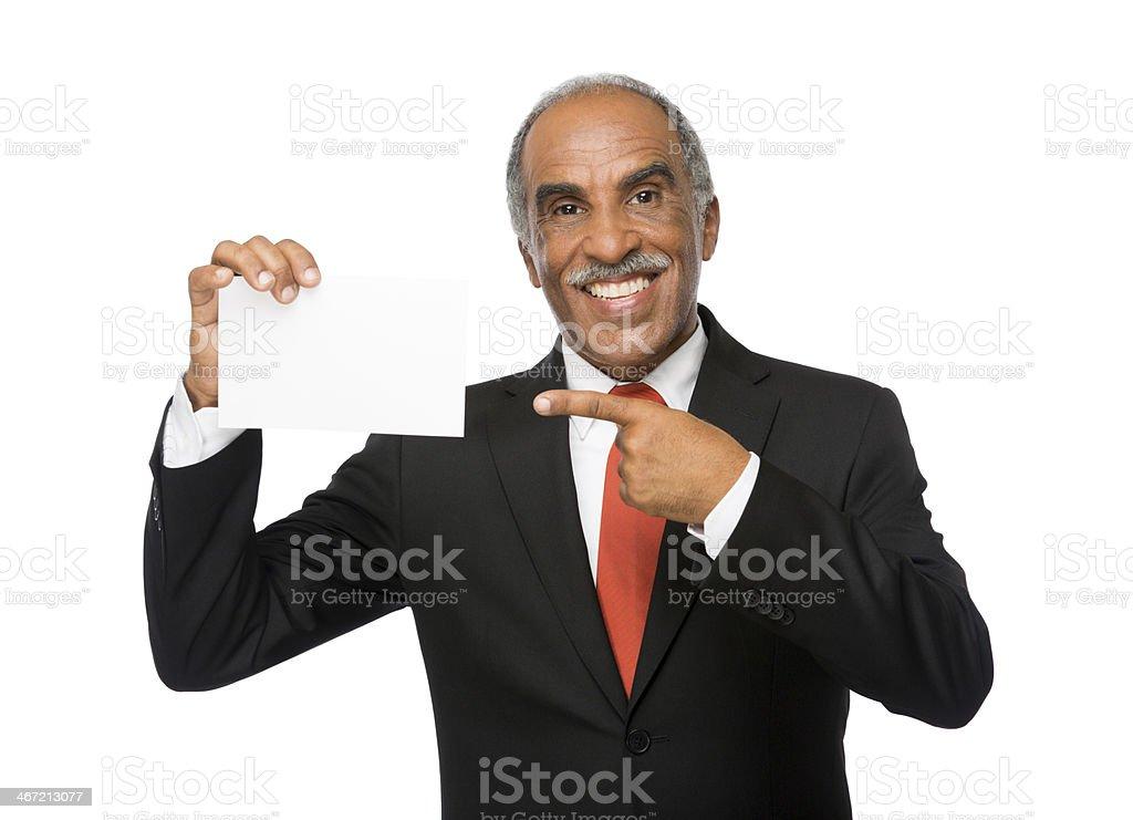 Latin executive pointing to card royalty-free stock photo