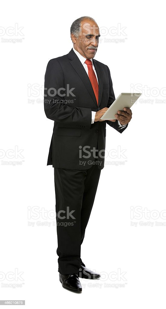 Latin executive reading from tablet royalty-free stock photo