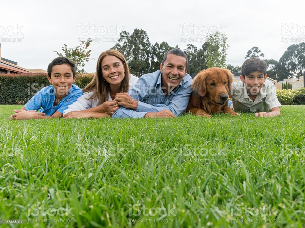 Latin family looking happy outdoors stock photo