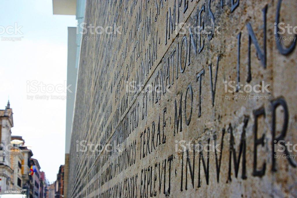 Latin inscription in Ara Pacis di Augusto royalty-free stock photo