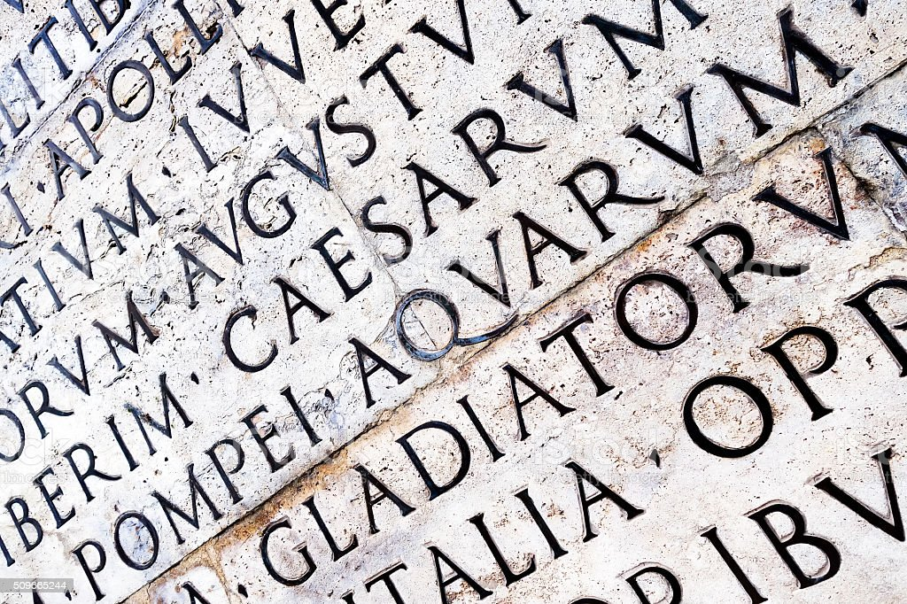 Latin inscription on Ara Pacis wall in Rome, Italy stock photo