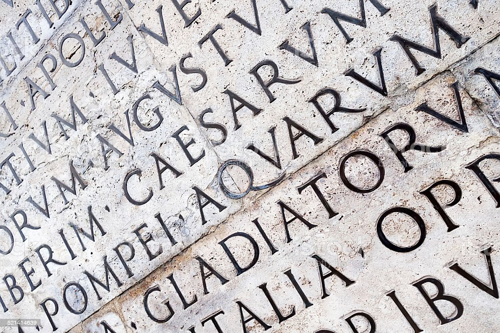 Latin inscription on  wall in Rome, Italy stock photo