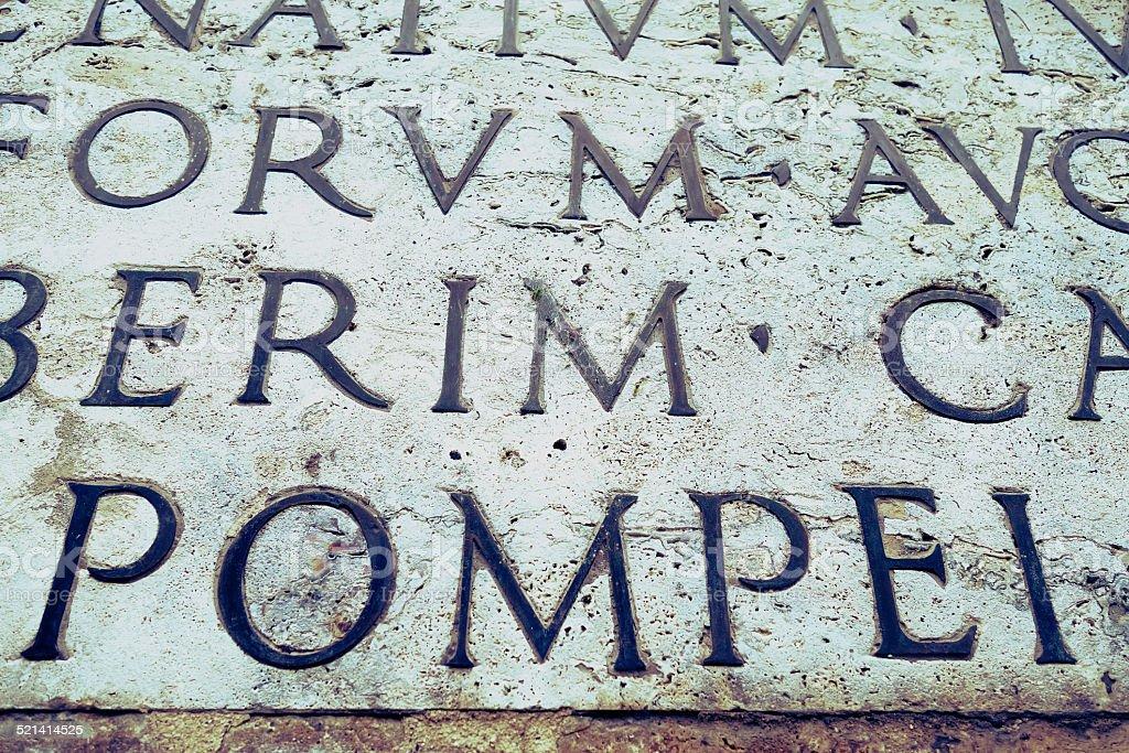 Latin inscription on  wall, Italy stock photo